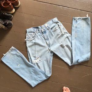 Vintage heavy distress Levi 505 light wash jeans